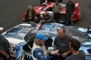 Cindi debriefs crew chief and lead mechanic